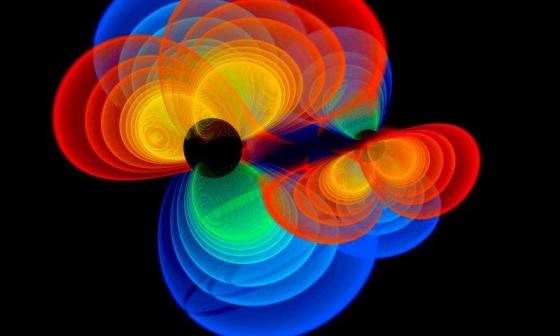 黑洞合併的產生引力波的模擬圖片