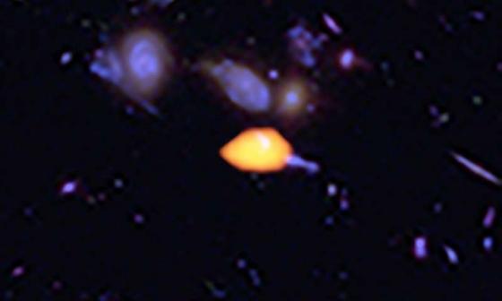 圖像中橙色的星系含有豐富的一氧化碳