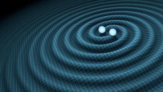 兩個互相環繞的重物產生重力波時空漣漪